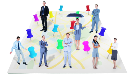 Business people spread out across a board with pins